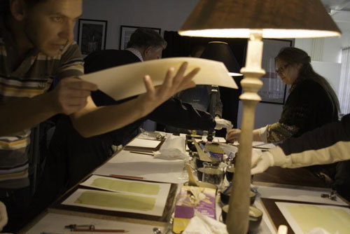 Inspecting prints during a workshop