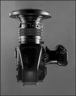Pictured is the 5″ magnifier and its adaptor which seats the magnifier and secures it with an accessory ring in front, a 95mm accessory ring at the rear of the adaptor(facing the lens barrel), enables a series of step-up rings to be used to mate it with the medium format 645 leaf shutter lens as shown.