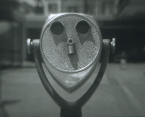 Smiling Face Photographed with the rear element from a Kodak projection lens attached to the front accessory filter thread of a MF 645 80mm lens shell, shot at Fisherman's Wharf in Redondo Beach.