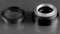 Pictured above is the rear element unscrewed from an old Kodak projection lens, right is the iris diaphragm sandwiched in between step up/step down rings in front and a threaded ring at the rear.