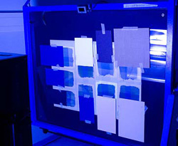 Testing cyanotype papers by exposing with UV-light.