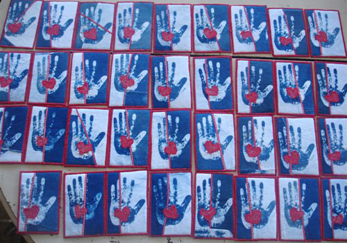 A batch of cyanotype fibre postcards made by Linda Stemer, ready to be sent out