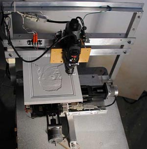 Two 6-inch positioning stages (X&Y) move the work under the stationary gantry which holds the Z-axis stage.