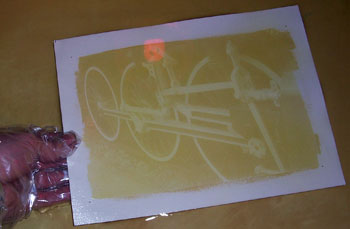 The paper is developed in warm water to remove the unexposed areas of emulsion leaving only a positive image.