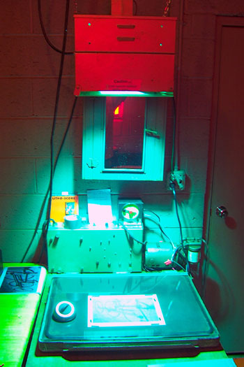 The paper and negative are placed in a vacuum frame (or sandwiched between two glass plates) and exposed to a UV light source. Sunshine works very well as a UV source, but is a little harder to control exposure.