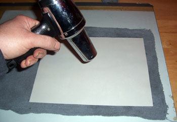 A heat gum or hair dryer will help dry the paper faster.