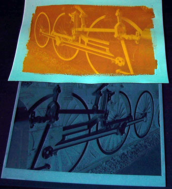 After exposure to UV light the image becomes visible as a positive in the emulsion.
