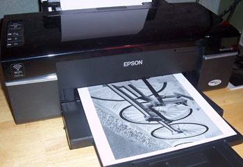 Use photo editing software to turn the image into a negative and then print the negative onto plain white paper.