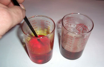 The dichromate and gum solutions are prepared and stored in separate containers.