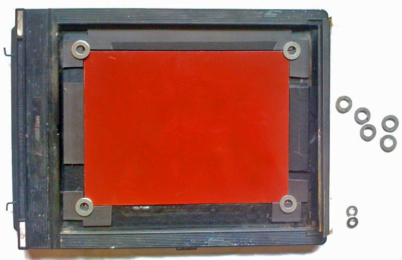 Image of a large format film holder modified to hold metal plates