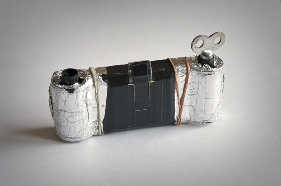 One of my matchbox pinhole cameras, covered in aluminum foil to keep the light out.