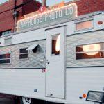 A large-format photography studio and darkroom inside a vintage camper
