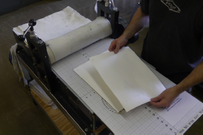 Place a second piece of printmaking paper (dry) over the blotted printmaking paper.