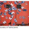 Some of Tasha Lewis's cyanotype butterflies affixed to metal doors